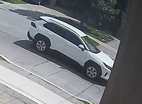 Security camera image of suspect vehicle, White, 2019 RAV4