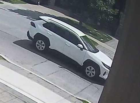 Security camera image of suspect vehicle, White, 2019 RAV4